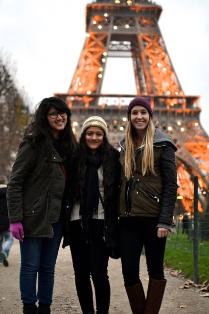 Rhea (left) with her friends in Paris in front of the Eiffel Tower.