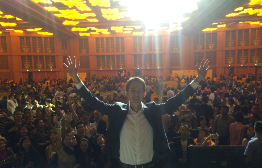 Spencer Li speaking to thousands at the National Achievers Congress (NAC)