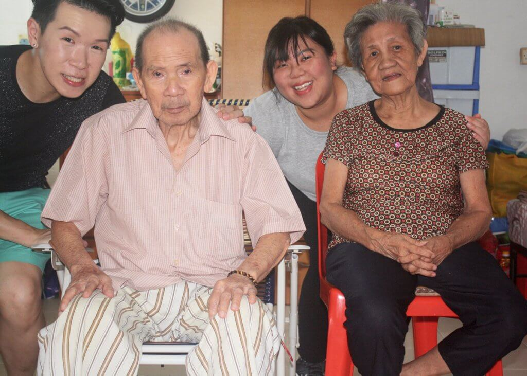 Rachel Tan and Timothy Huang visiting an elderly couple