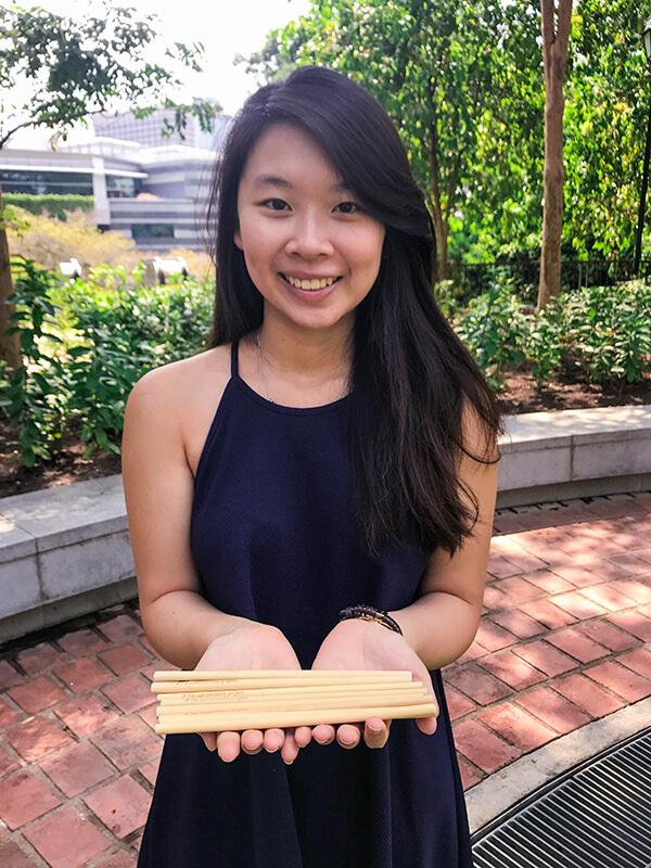 Joline showcasing her bamboo straws