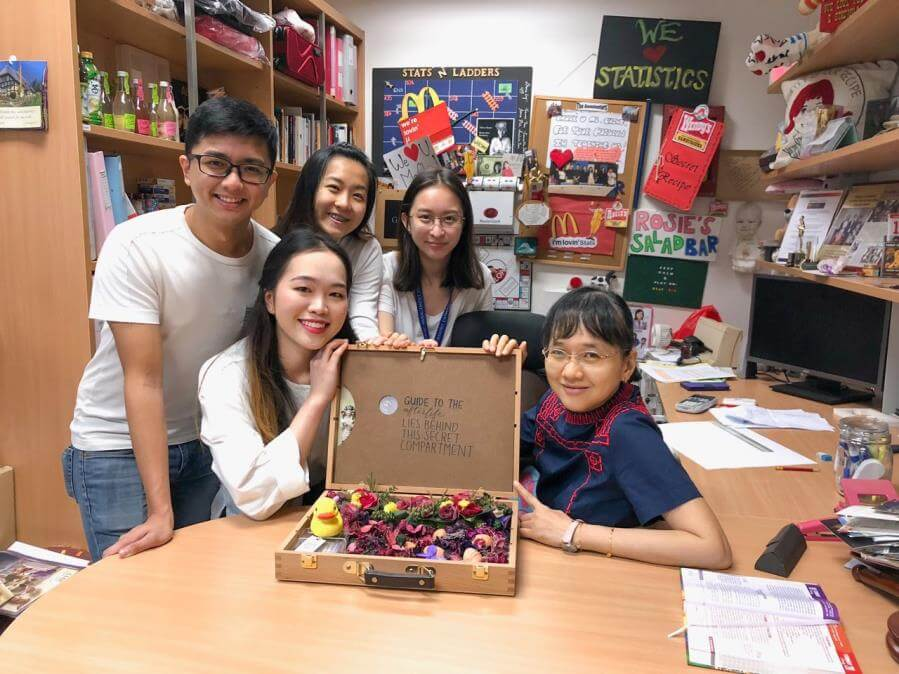 Senior lecturer Rosie Ching with her students, including Theodora Ng