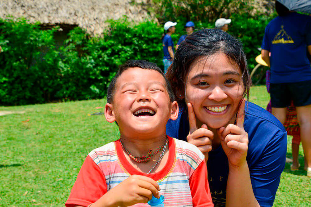 Agalia with new Hua Tat friend during Games Day with village children