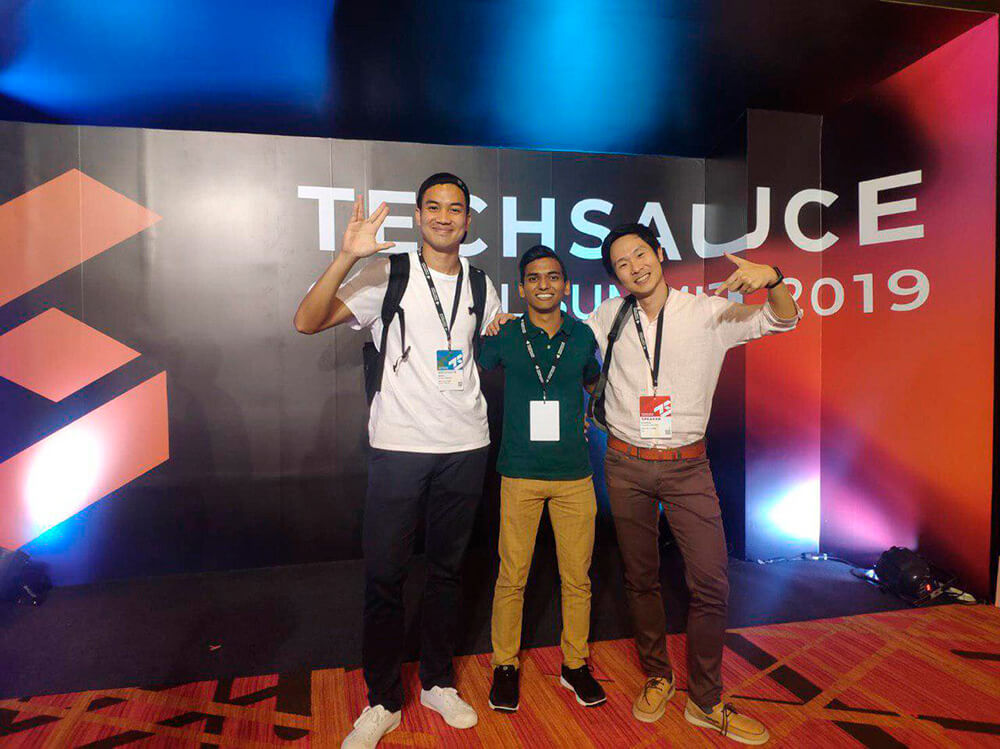 Razzaq with his bosses, Mr Adison and Dr Kanapon, at the Techsauce Conference 2019