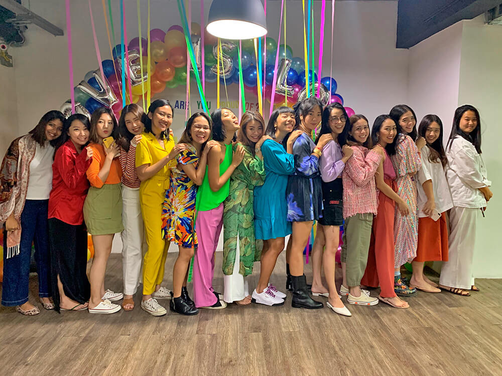 Pomelo employees forming rainbow colours during Pride Month celebrations