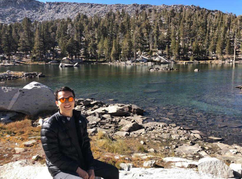 Brandon Ong by a lake.
