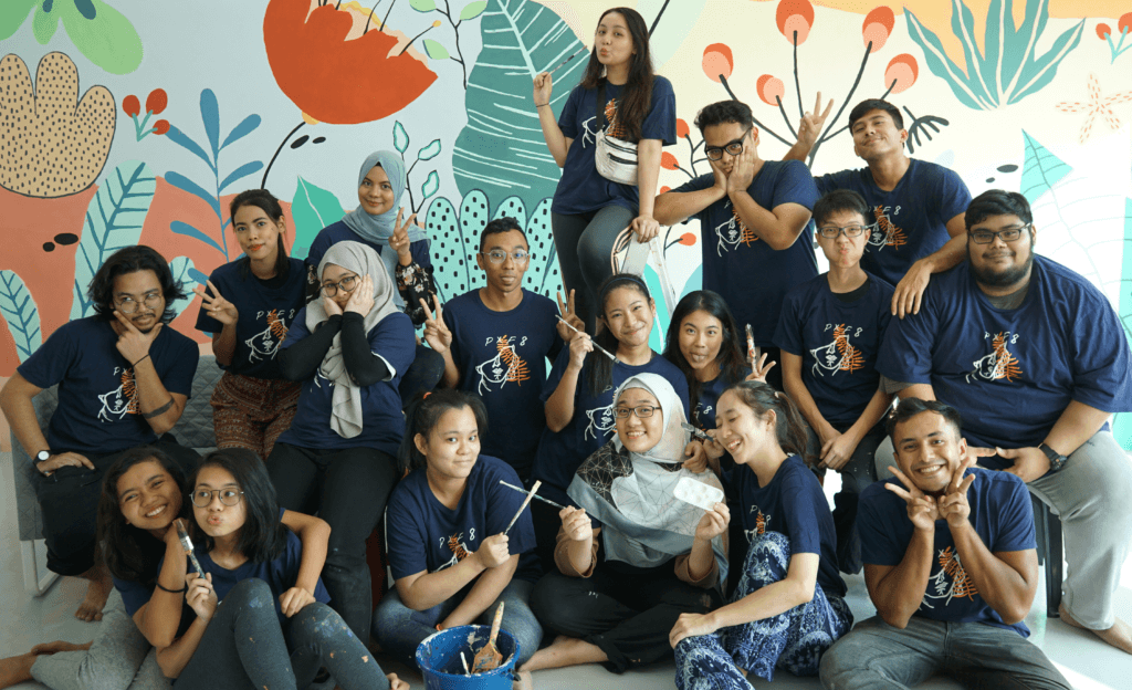 Aisyah (front row, 1st from left) participating in an Overseas Community Service Project (OCSP), Project Xing Fu 8