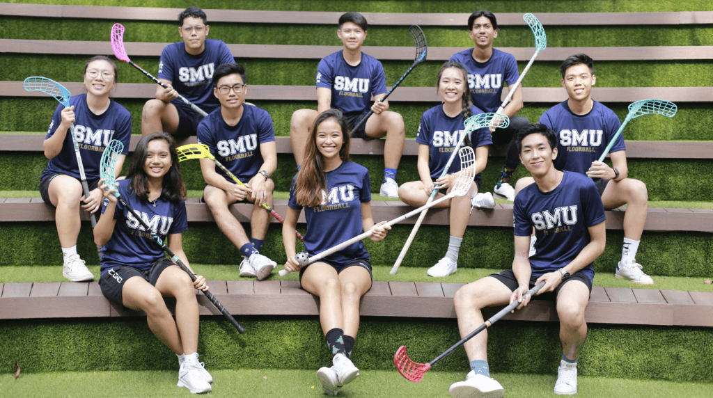 Aisyah (front row, 1st from left) is the former Vice-President of the SMU Floorball Team